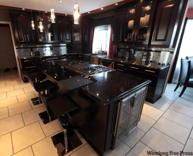 black kitchen cabinets with black countertops decor