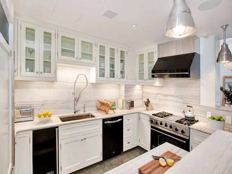white kitchen cabinets with black appliances decor