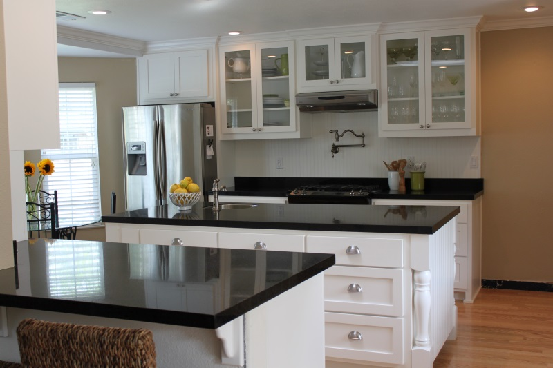 White kitchen cabinets with black granite countertops decor