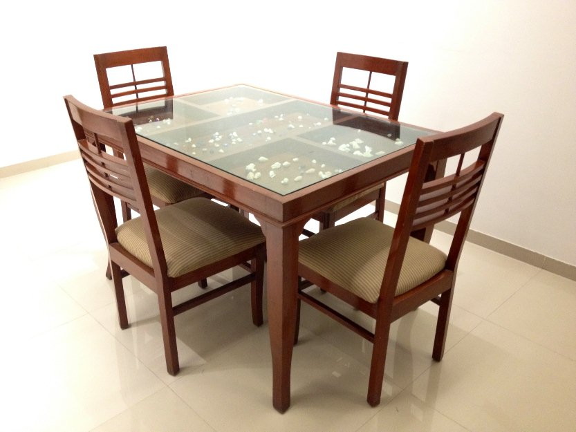 Glass top dining table elegant addition decor for Dining table top decor